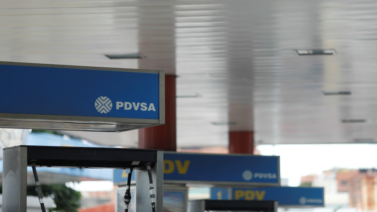 Venezuela | Believe it or not, but a litre of petrol in the South American country costs a paltry Rs 0.71 per litre. In India, it costs over 100 times. | Image shows a corporate logo of state-owned oil company PDVSA at a gas station in capital Caracas. (Image: Reuters)