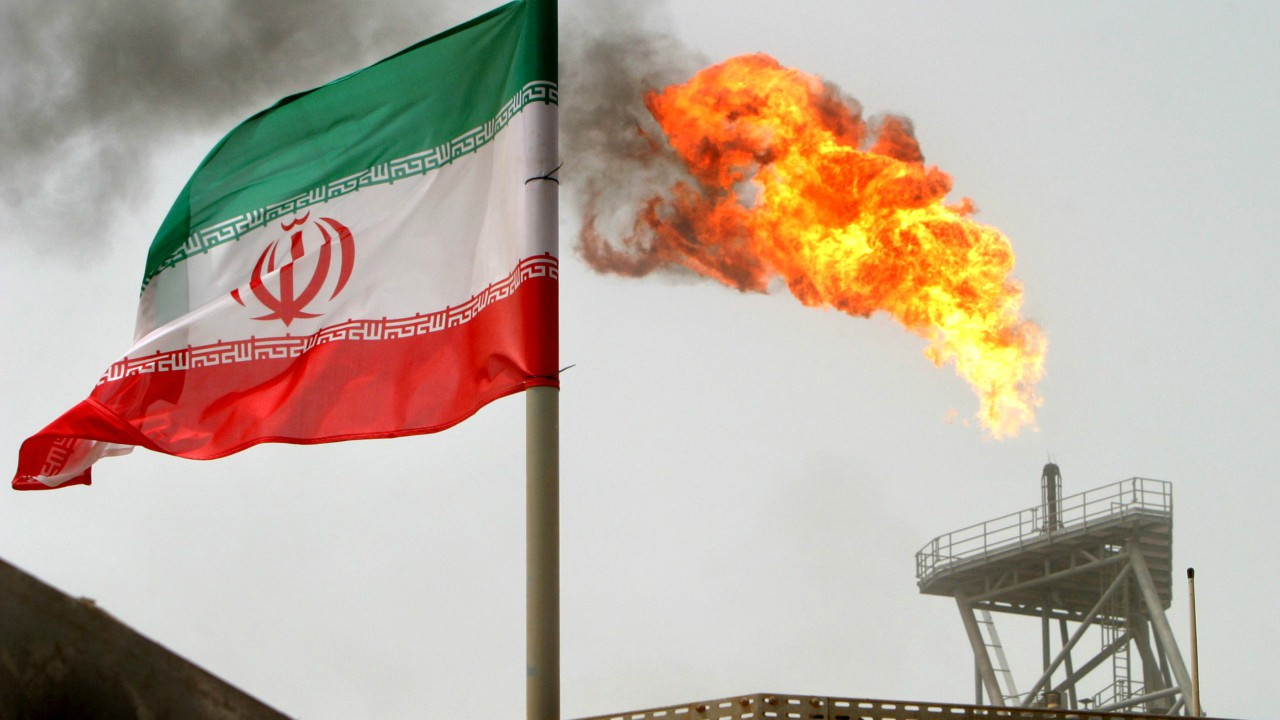 Iran | Cost per litre - Rs 20.53 | A gas flare at an oil production platform is seen in the Soroush oil fields alongside an Iranian flag in Iran. (Image: Reuters)