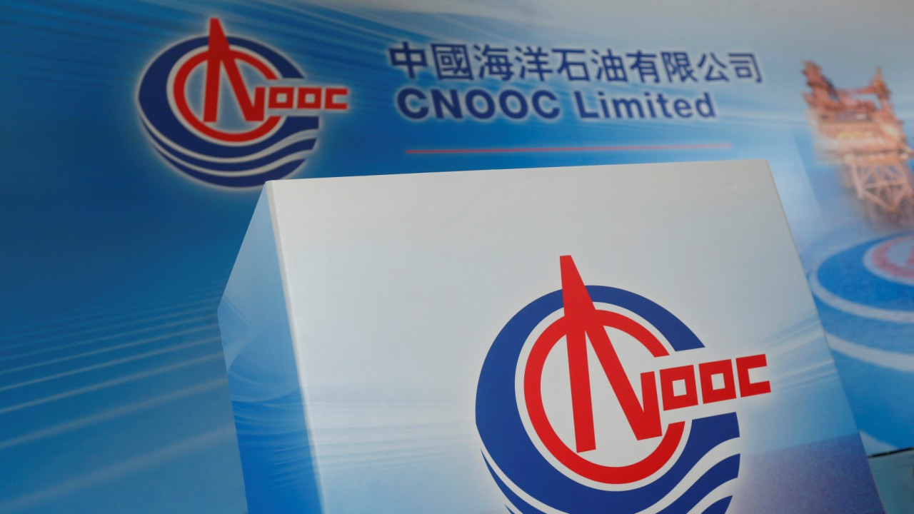 HONG KONG: Cost per litre - Rs 143.63   Logos of China National Offshore Oil Corporation (CNOOC) are displayed at a news conference on the company's interim results in Hong Kong. (Image: Reuters)