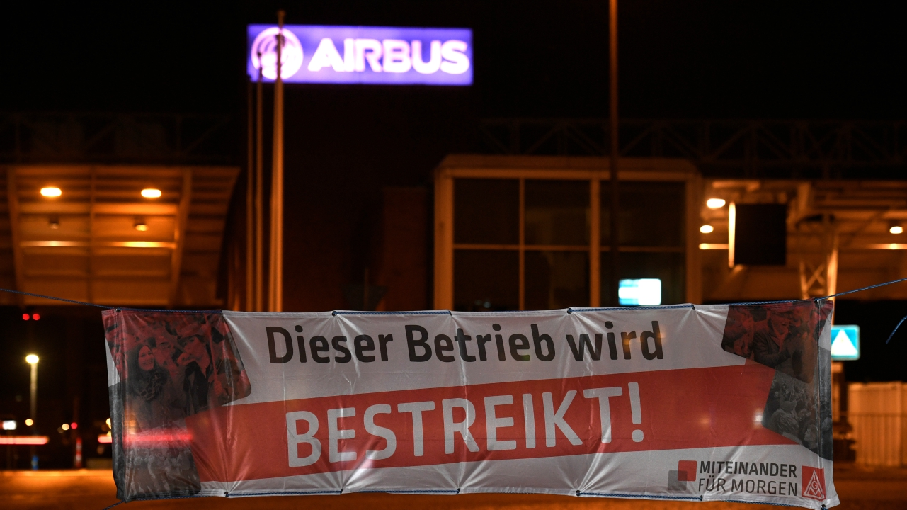 "A banner that reads: ""We are on strike"" is seen in front of the main entrance of plane maker Airbus during a 24-hour strike of German Metal Workers Union IG Metall in Hamburg-Finkenwerder, Germany. (Reuters)"