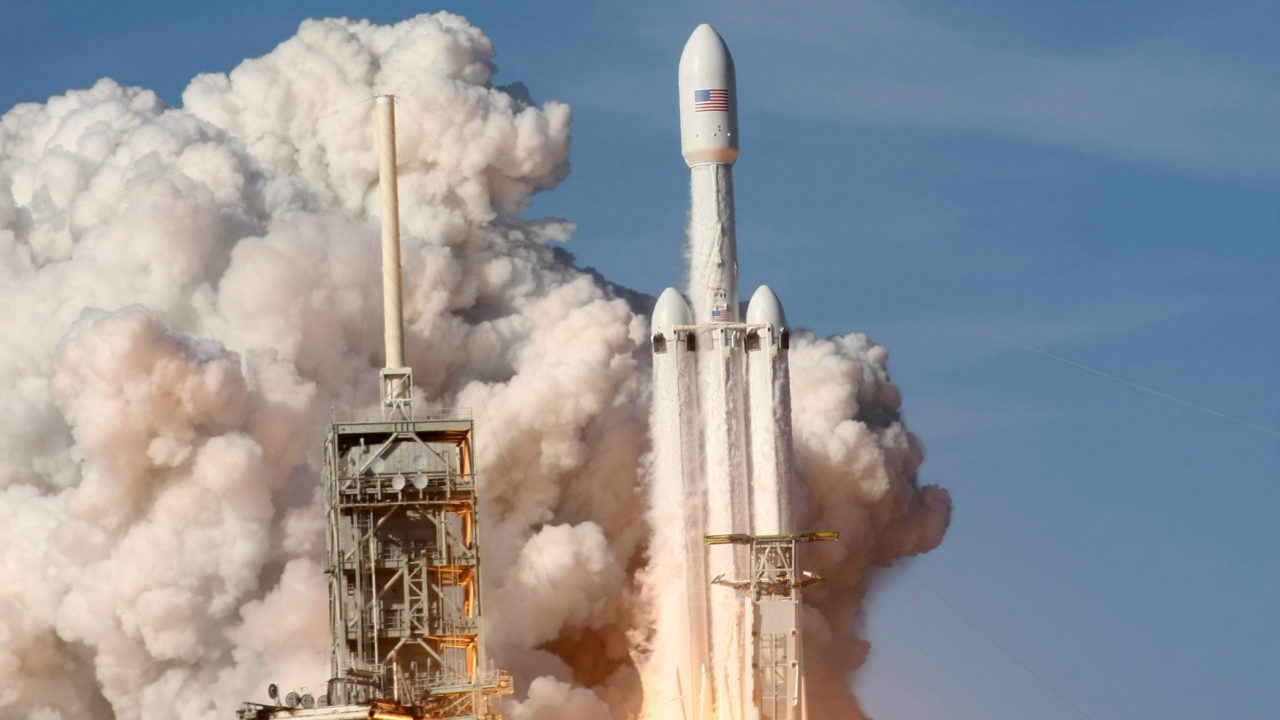 The 23-story-tall jumbo rocket, carrying a cherry red Tesla Roadster from the assembly line of Musk's electric car company as a mock payload, thundered off its launchpad in billowing clouds of steam and rocket exhaust at 3:45 p m (2045 GMT) from the Kennedy Space Center in Cape Canaveral. (Image Courtesy: Reuters)