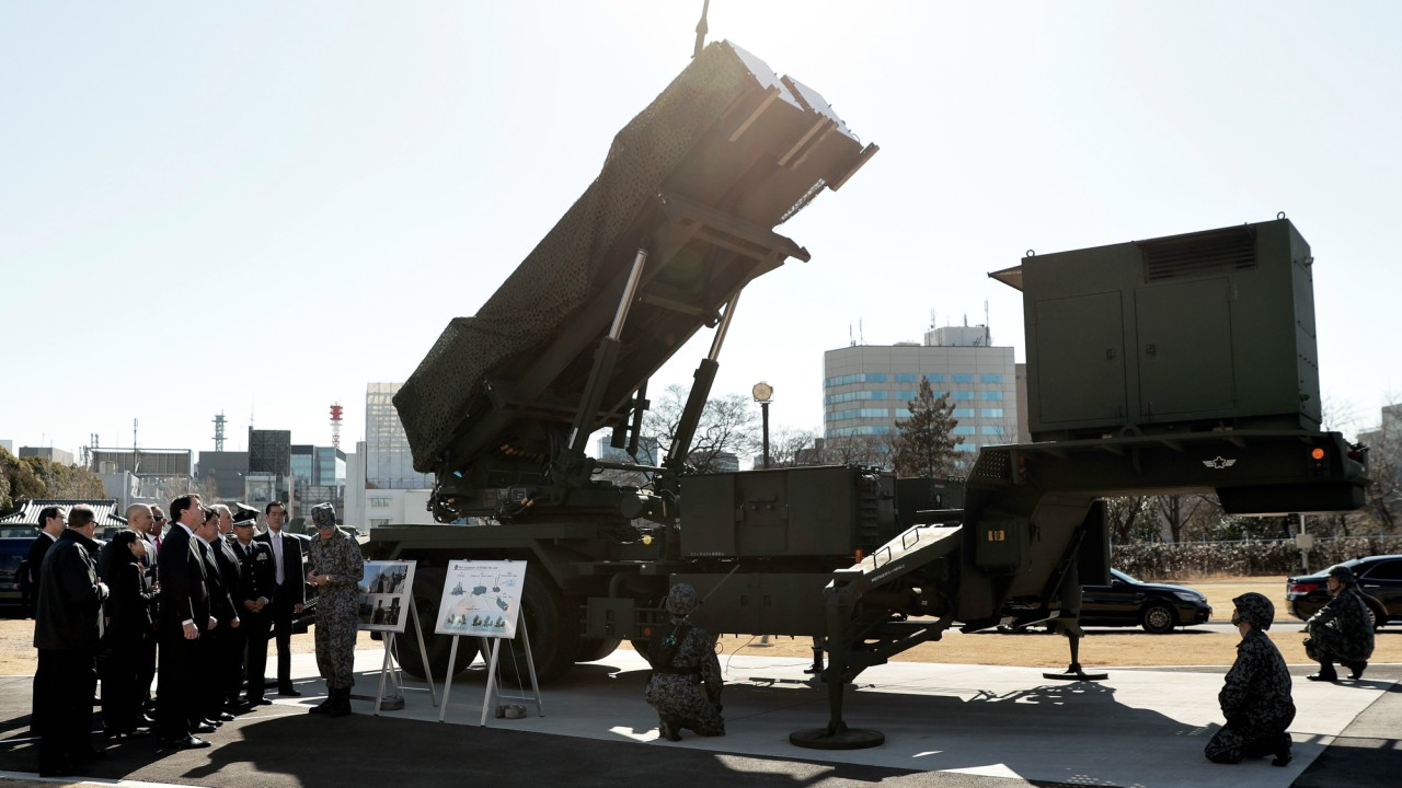 U.S. Vice President Mike Pence inspects the Patriot Advanced Capability-3 (PAC-3) missile launch system with Itsunori Onodera, Japan's defense minister, during a demonstration at the Ministry of Defense in Tokyo (REUTERS)