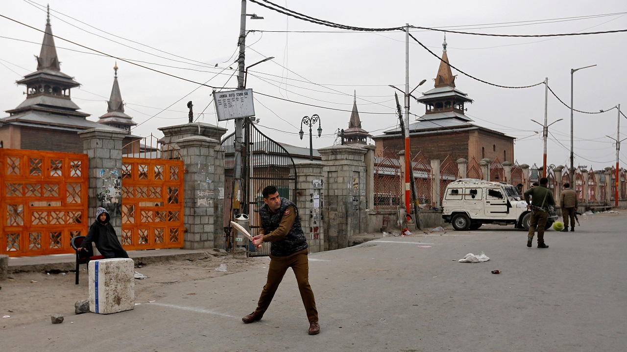 An Indian police officer plays cricket in a deserted road during a strike called by Kashmiri separatists to mark the death anniversary of Mohammad Maqbool Bhat, founder and leader of Jammu Kashmir Liberation Front (JKLF), a Kashmiri separatist party, who was hanged and buried in an Indian jail on February 11, 1984 on charges of killing an Indian intelligence officer, in Srinagar. (Reuters)