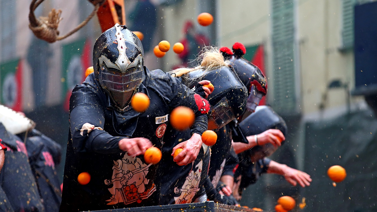 Members of rival teams fight with oranges during an annual carnival battle in the northern Italian town of Ivrea, Italy. (Reuters)