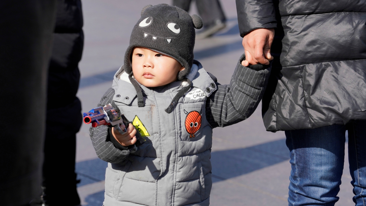 A boy is seen at Beijing Railway Station after arriving by train to China's capital during the Chinese Lunar New Year travel rush as the annual Spring Festival holidays end in Beijing, China February 22, 2018. (Reuters)