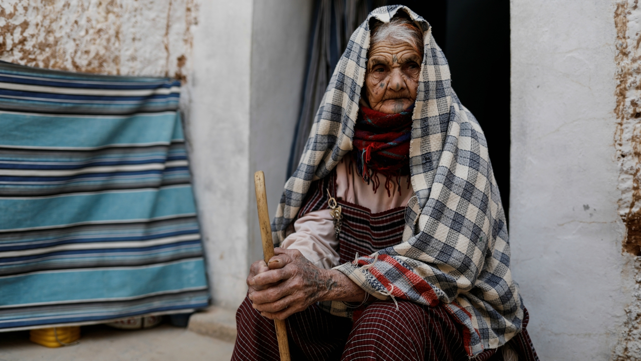 Mariem, 89, sits outside of her troglodyte house on the outskirts of Matmata, Tunisia. (REUTERS)