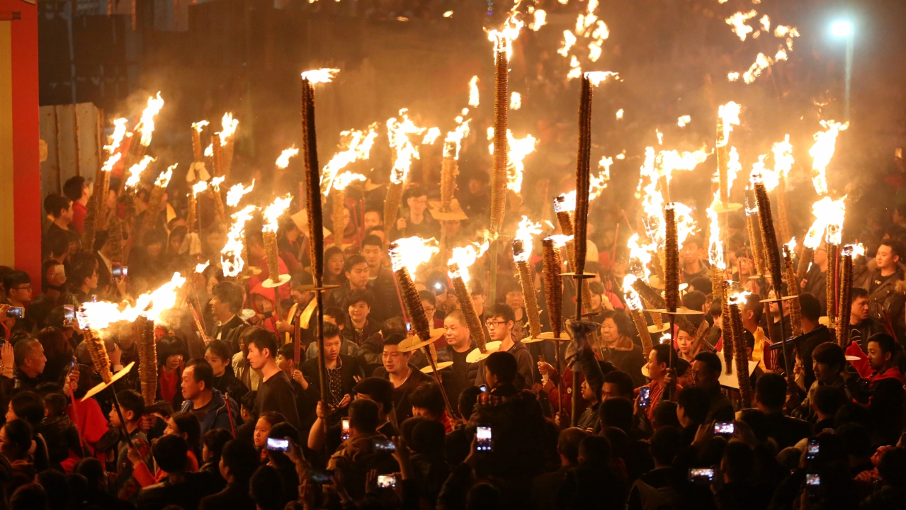 Villagers holding torches parade around a village as part of their Lunar New Year celebration to pray for good fortune, in Jinjiang, Fujian province, China. (REUTERS)