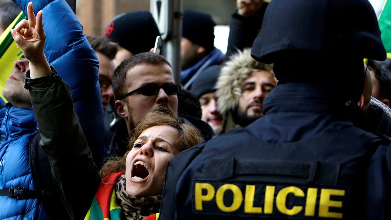 Supporters of Kurdish Democratic Union Party (PYD) former leader Saleh Muslim shout slogans in front of a Czech court, which released Muslim from custody, in Prague, Czech Republic. (Reuters)