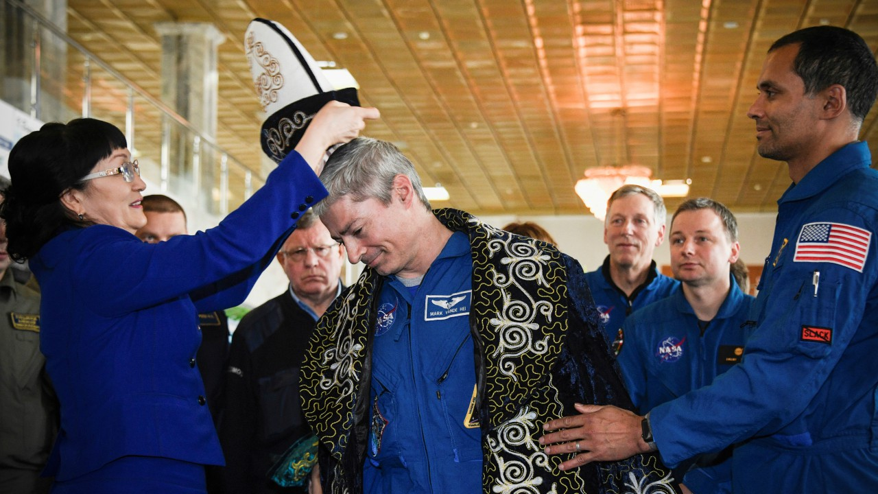 International Space Station crew member Mark Vande Hei of the U.S. receives a traditional Kazakh hat after a news conference in the town of Dzhezkazgan (Zhezkazgan), Kazakhstan. (REUTERS)