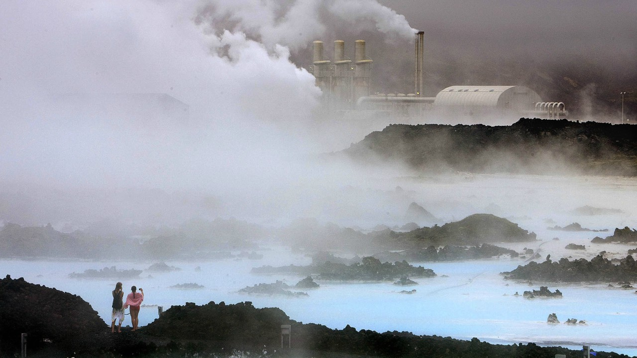 Iceland | Cost per litre - Rs 149.59 | Visitors take pictures of the Svartsengi geothermal power plant near the Blue Lagoon hot springs outside the town of Grindavik. (Image: Reuters)