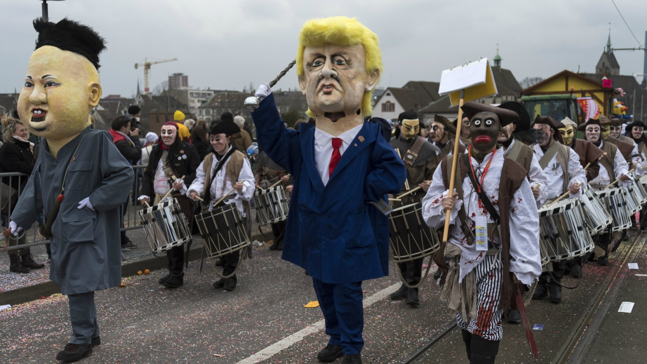 Revelers wearing a Kim Jong-un and a Donald Trump costumes participate at the carnival procession in Basel, Switzerland. (AP/PTI)