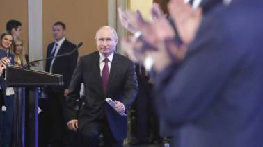 Vladimir Putin on track for commanding win as Russians head to polls