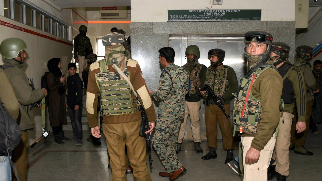 Security personnel stand guard during a search operation after an LeT militant escaped from the police custody with the assailants after Lashkar-e-Taiba militants attacked SMHS hospital, in Srinagar on Tuesday. (PTI)