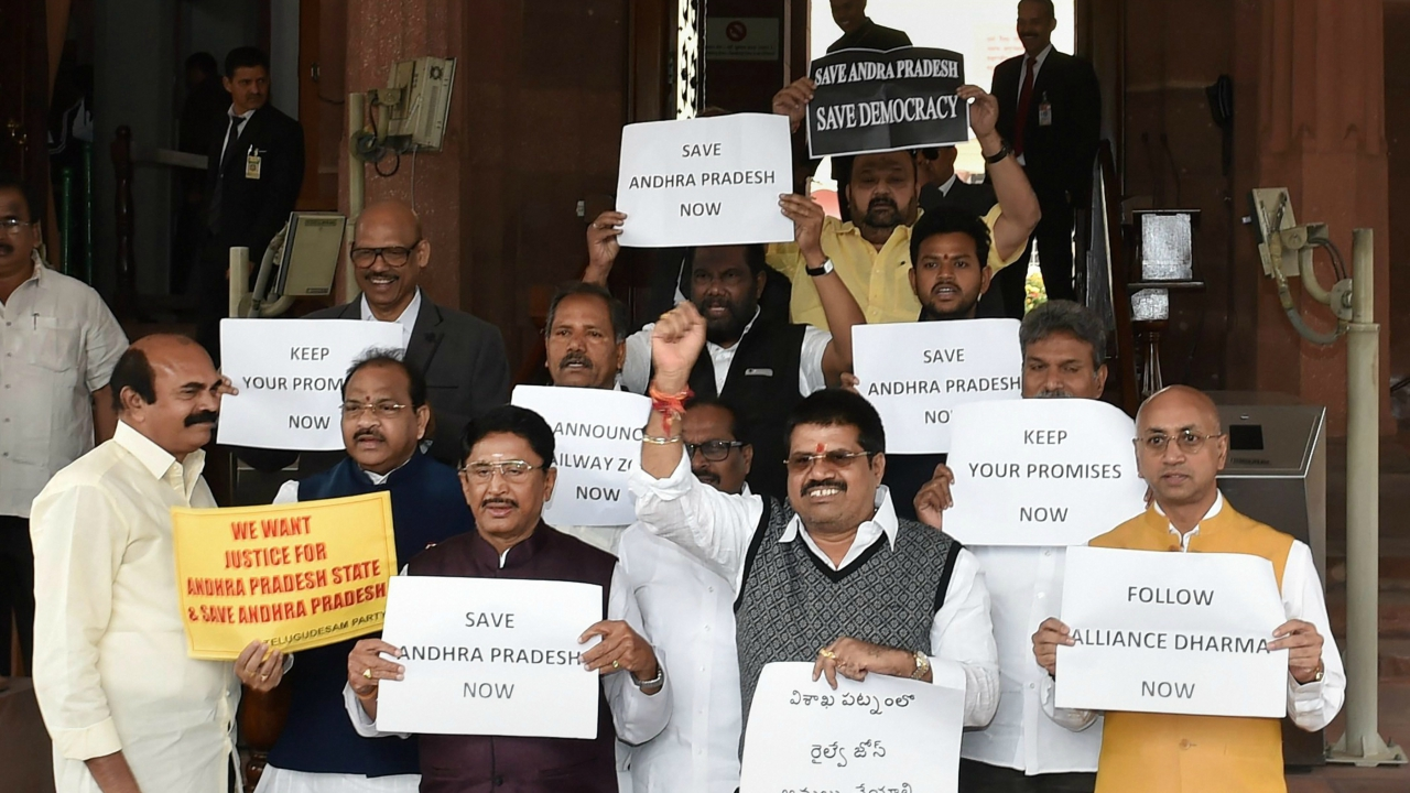 TDP members stage a protest demanding special package for Andhra Pradesh state, during the budget session of Parliament in New Delhi on Tuesday. (PTI)