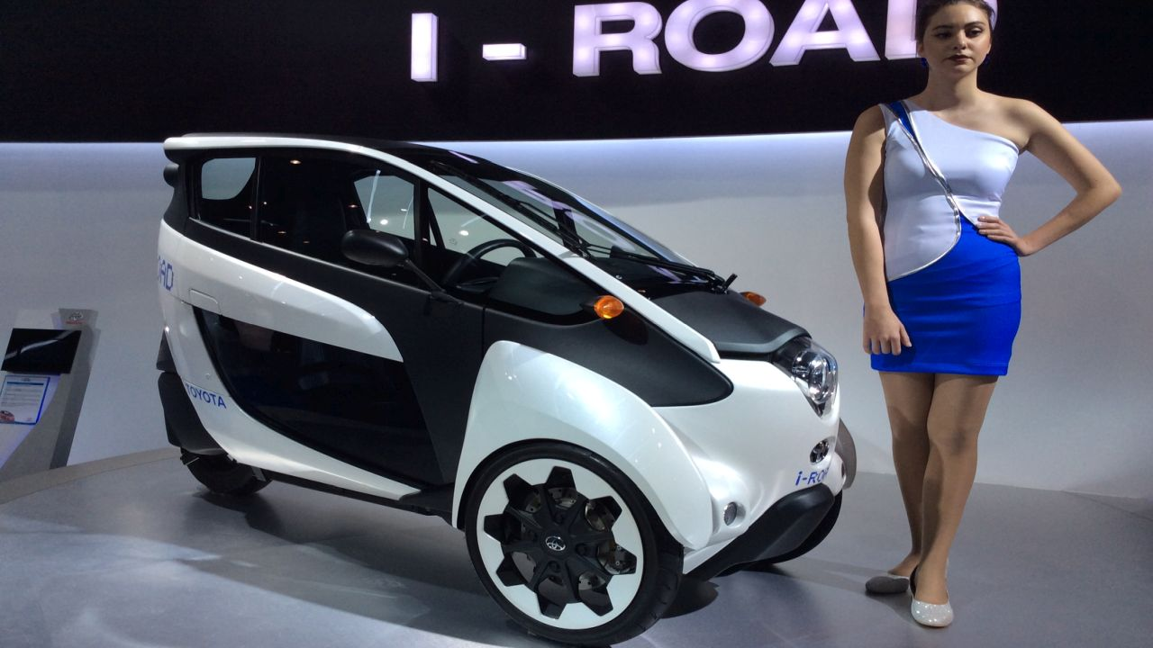 Toyota iRoad is twin seater, three wheeler concept. Powered by lithium ion batteries it can travel for 50kms on a single charge.