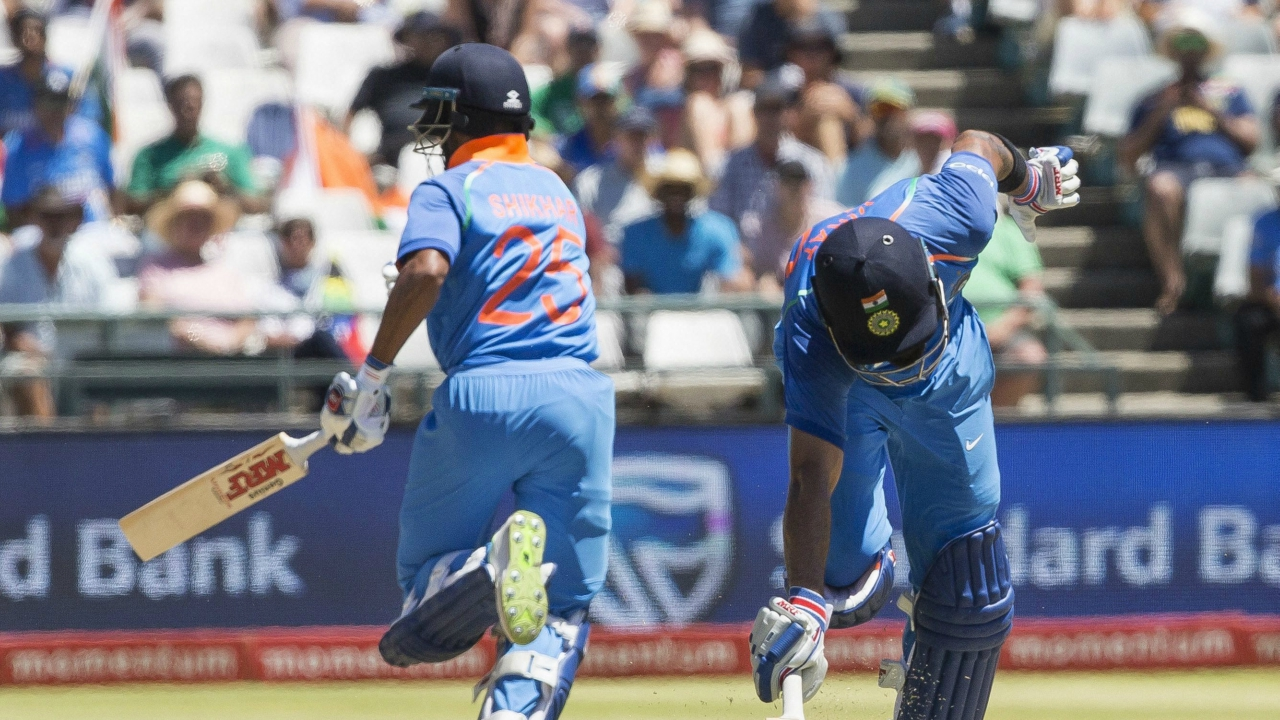 Indian batsman Shikhar Dhawan, left, and captain Virat Kohli hustle to make it back to the wicket during a One Day International match between South Africa and India at Newlands Stadium, in Cape Town, South Africa, Wednesday, Feb 7, 2018. (AP/PTI)