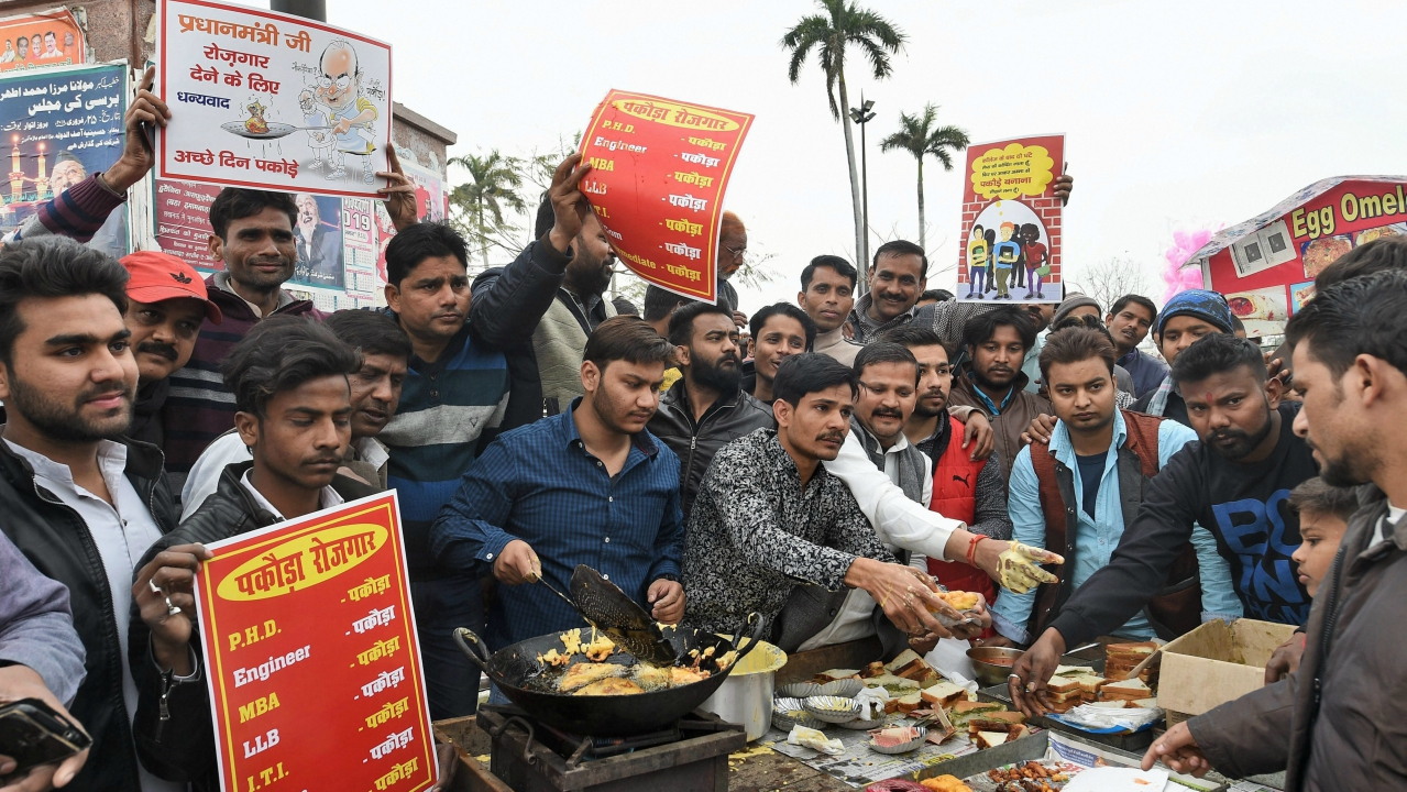Youth claiming to be unemployed sell 'Pakoras' to counter Prime Minister Narendra Modi's statement on employment, in an old area of Lucknow on Wednesday. (PTI)