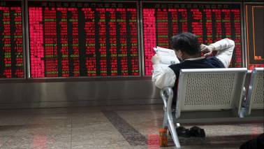 Asian shares hobbled by new tariff threat