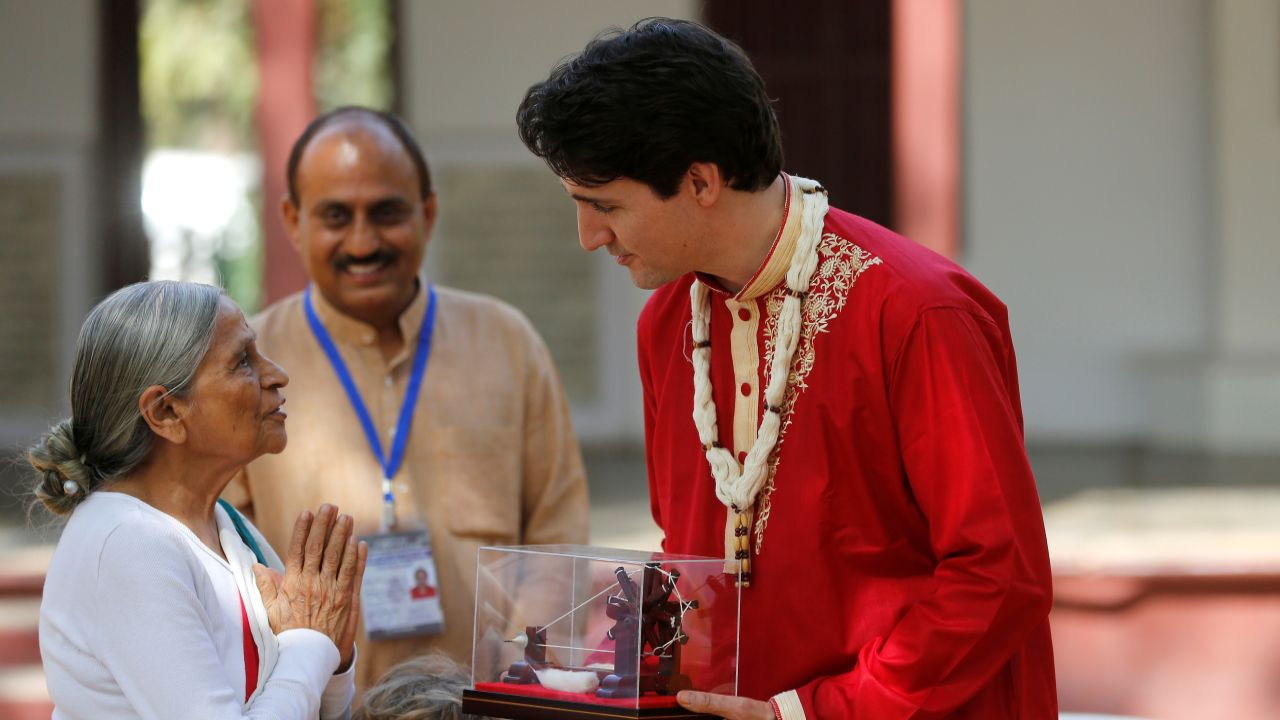 Justin Trudeau receives a memento during his visit to Gandhi Ashram in Ahmedabad on Monday. (Reuters)