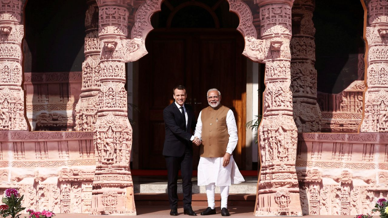 India's Prime Minister Narendra Modi (R) shakes hands with French President Emmanuel Macron as he arrives to attend the International Solar Alliance Founding Conference in New Delhi. (REUTERS)