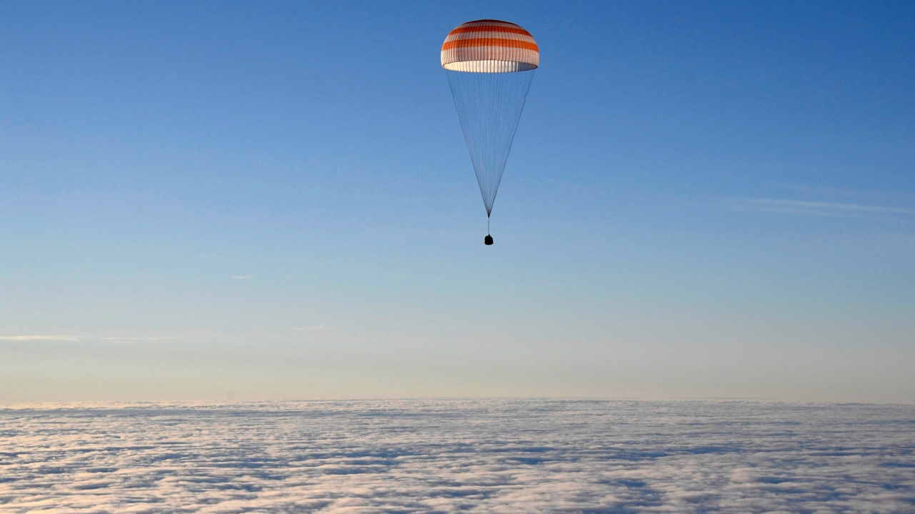 The Soyuz MS-06 capsule carrying the crew of Joe Acaba and Mark Vande Hei of the U.S., and Alexander Misurkin of Russia descends beneath a parachute just before landing in a remote area outside the town of Dzhezkazgan (Zhezkazgan), Kazakhstan. (REUTERS)