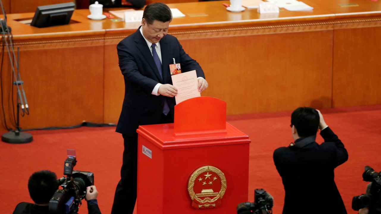 Chinese President Xi Jinping drops his ballot, during a vote on a constitutional amendment lifting presidential term limits, at the third plenary session of the National People's Congress (NPC) at the Great Hall of the People in Beijing, China. (REUTERS)