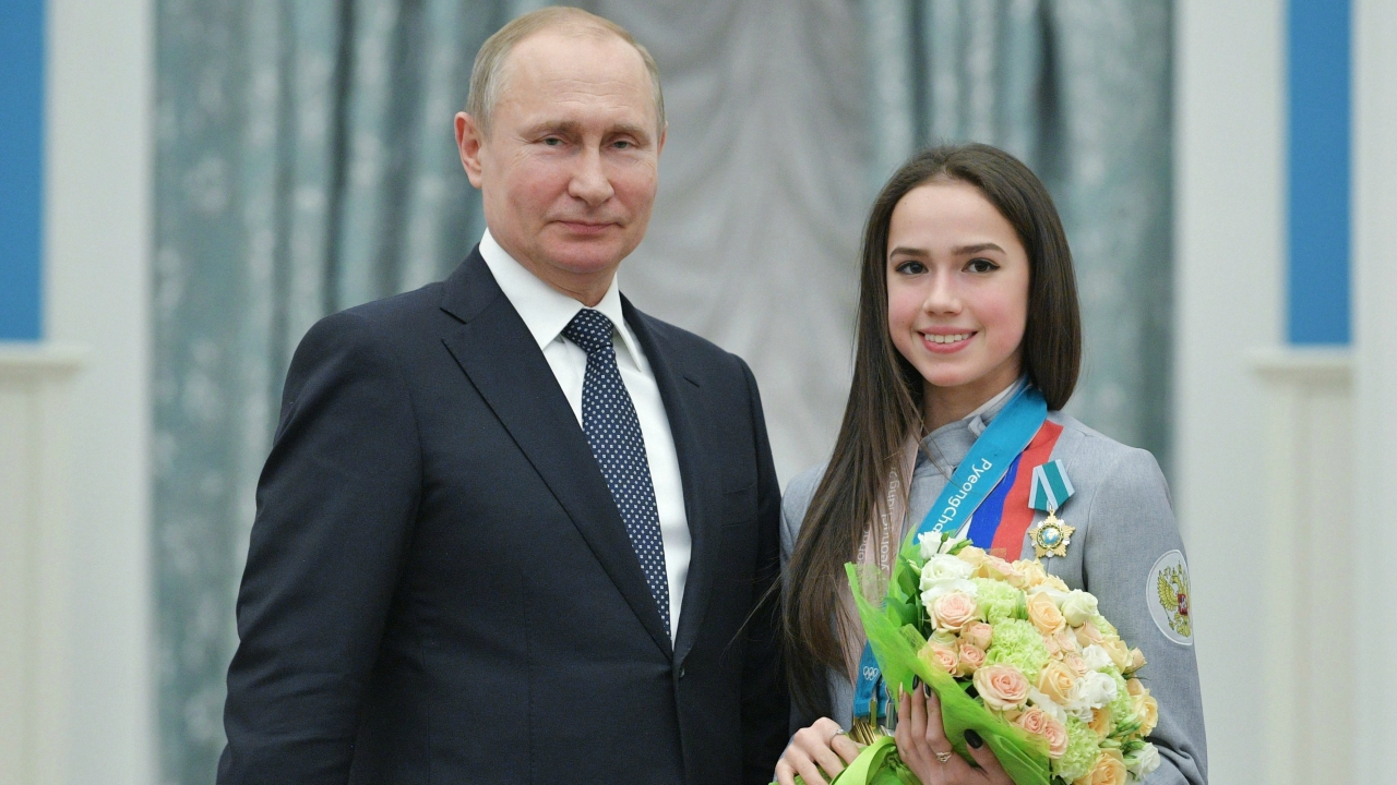 Russian President Vladimir Putin, and Alina Zagitova, gold medalist in the women's figure skating of the 2018 Pyeongchang Winter Olympic Games with the Order of Friendship pose for a photo during an awarding ceremony at the Kremlin in Moscow, Russia. (PTI)