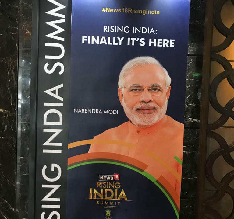 A poster of the Rising India Summit is seen at the venue of the event in New Delhi. (Image: News18)