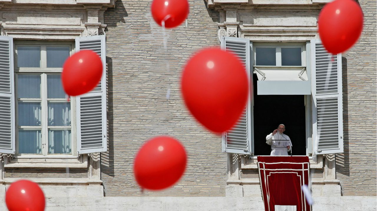 Balloons are released as Pope Francis leads the Angelus prayer in Saint Peter's Square at the Vatican. (REUTERS)