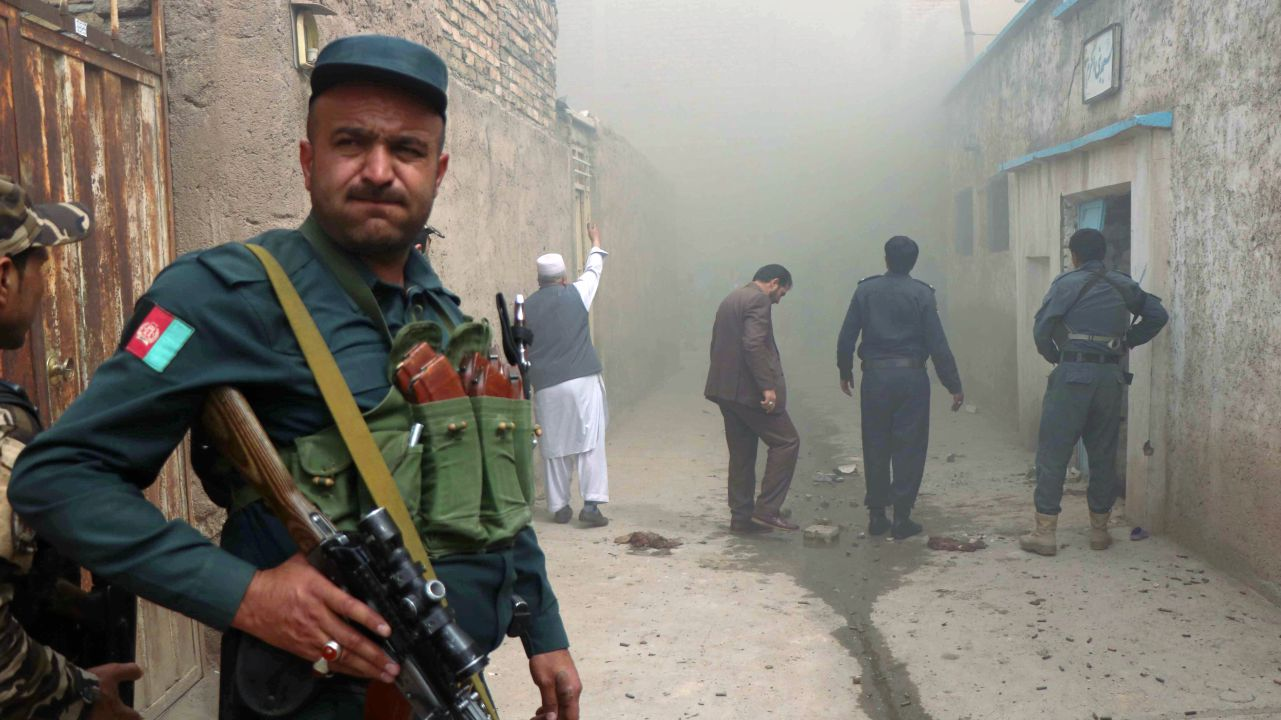 An Afghan police officer stands guard outside a Shi'ite mosque after a suicide bomb attack in Herat, Afghanistan. (REUTERS)