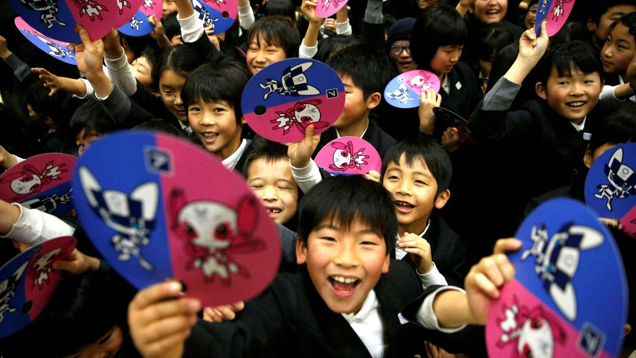 School students hold paper fans featuring the mascot for the Tokyo 2020 Olympics and Paralympics after Tokyo Olympics organizers unveiled the mascots selected by popular vote by elementary students across Japan at the Hoyonomori Gakuen School in Tokyo, Japan. (REUTERS)