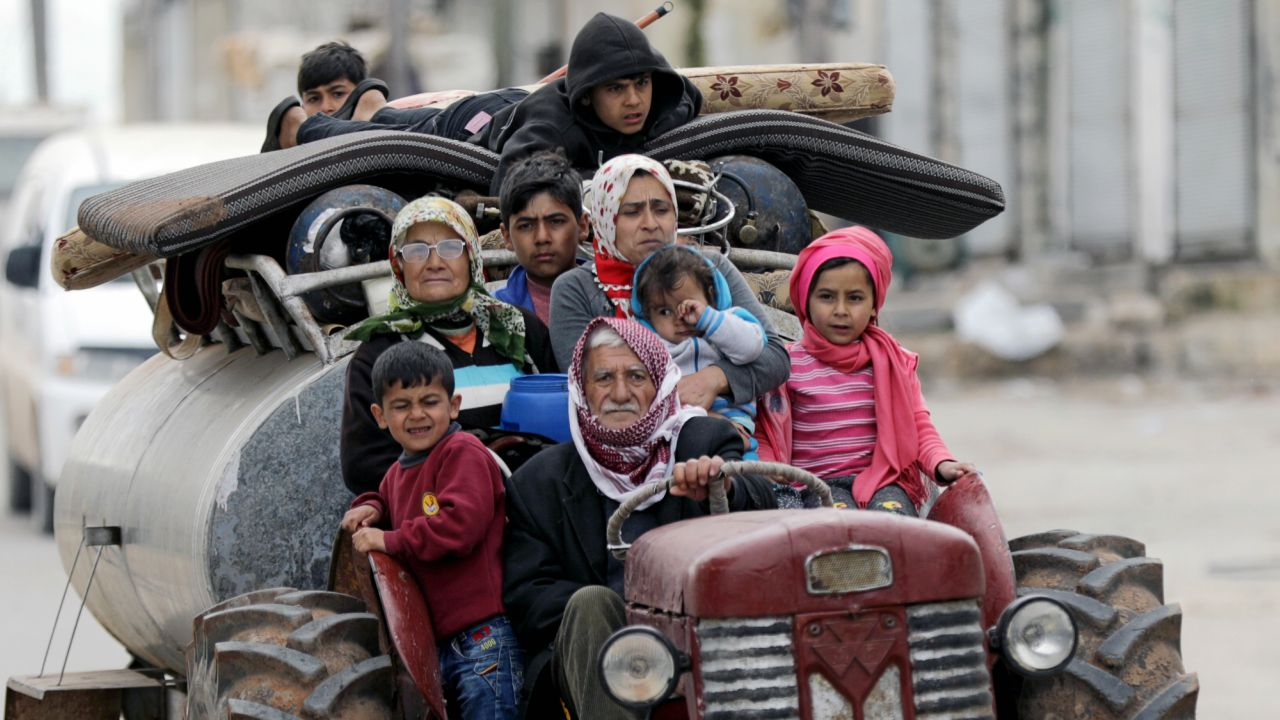 People flee after Turkish-backed Free Syrian Army fighters captured Khaldieh village in eastern Afrin, Syria. (REUTERS)