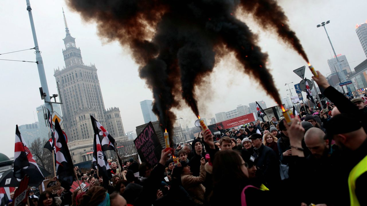 People gather during a protest against plans to further restrict abortion laws in Warsaw, Poland.  (REUTERS)