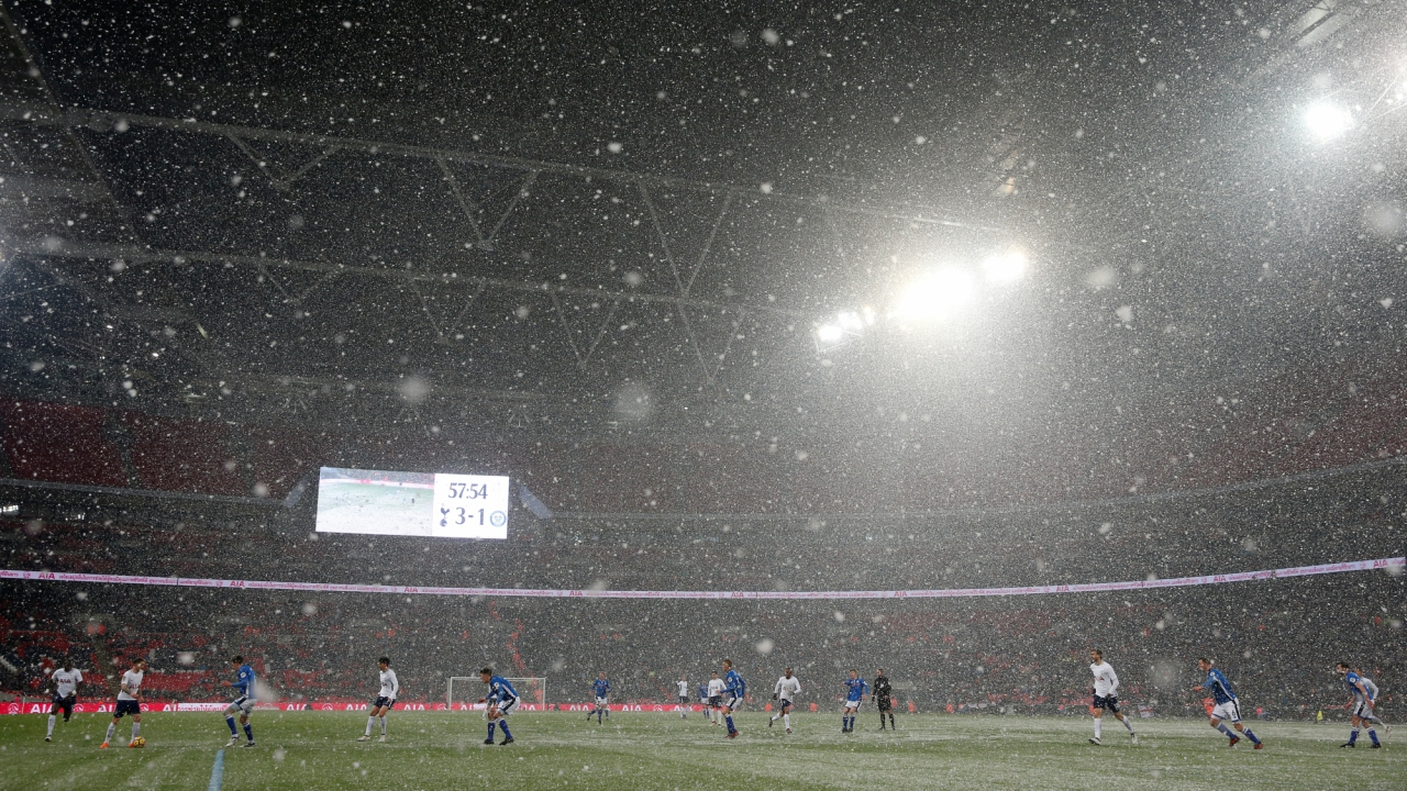 FA Cup Fifth Round Replay - Tottenham Hotspur vs Rochdale - Wembley Stadium, London, Britain: General view as snow falls during the match. (REUTERS)