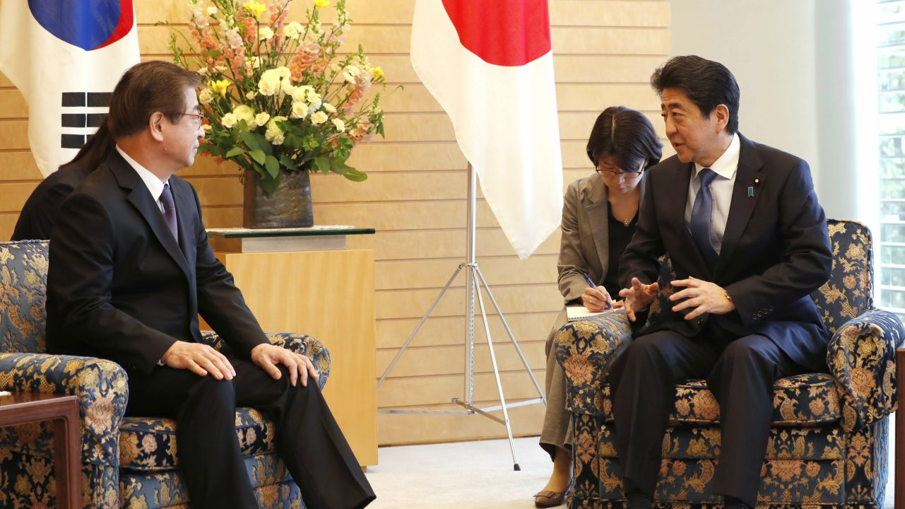 Japanese Prime Minister Shinzo Abe, right, speaks to South Korea's National Intelligence Service Chief Suh Hoon, left, during a meeting in Tokyo. (AP/PTI)