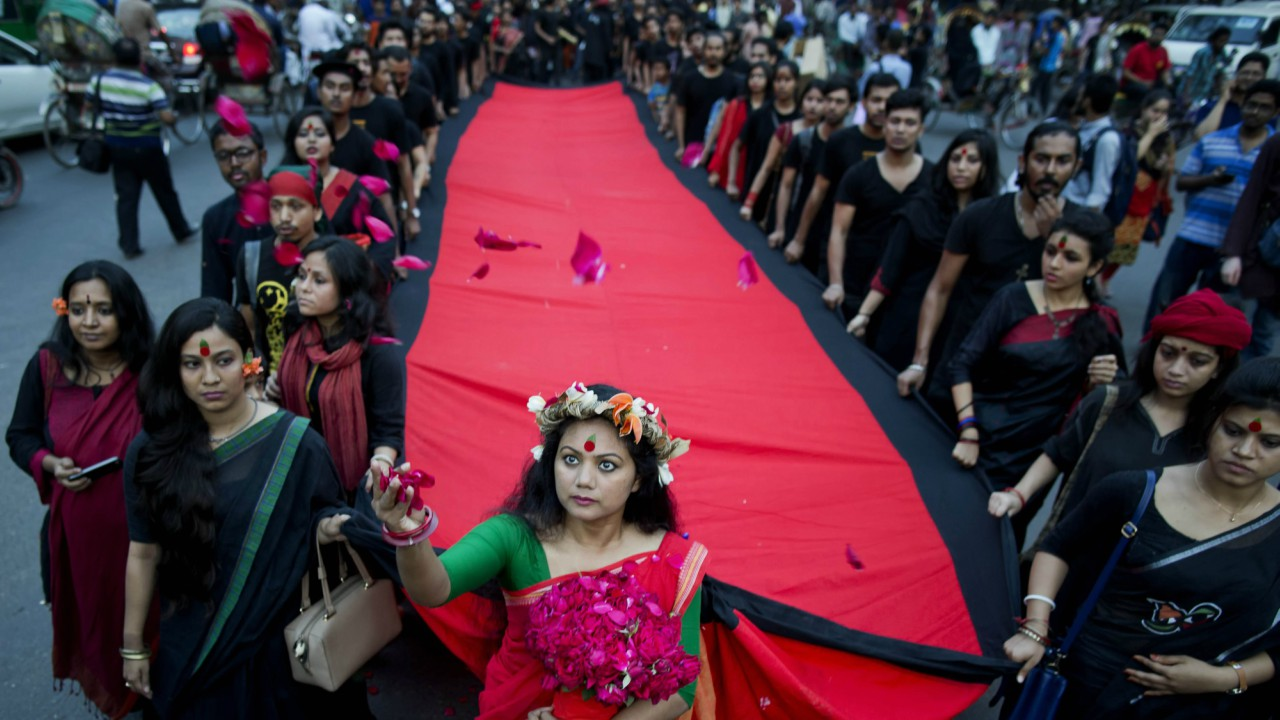 A Bangladeshi artist and social activist throws flowers as she participates with others in a rally in Dhaka, Bangladesh. The rally was organized in remembrance of those who were killed on March 25, 1971, a day ahead of the country's declaration of independence from Pakistan. (AP/PTI)