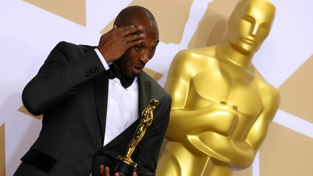 "Kobe Bryant with Best Animated Short Film Award for ""Dear Basketball"". (Reuters)"