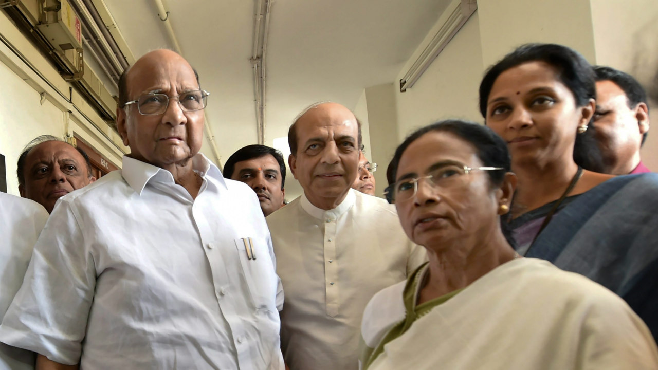 West Bengal Chief Minister and TMC chief Mamata Benerjee with NCP chief Sharad Pawar after a meeting at Parliament house in New Delhi on Tuesday.(PTI)