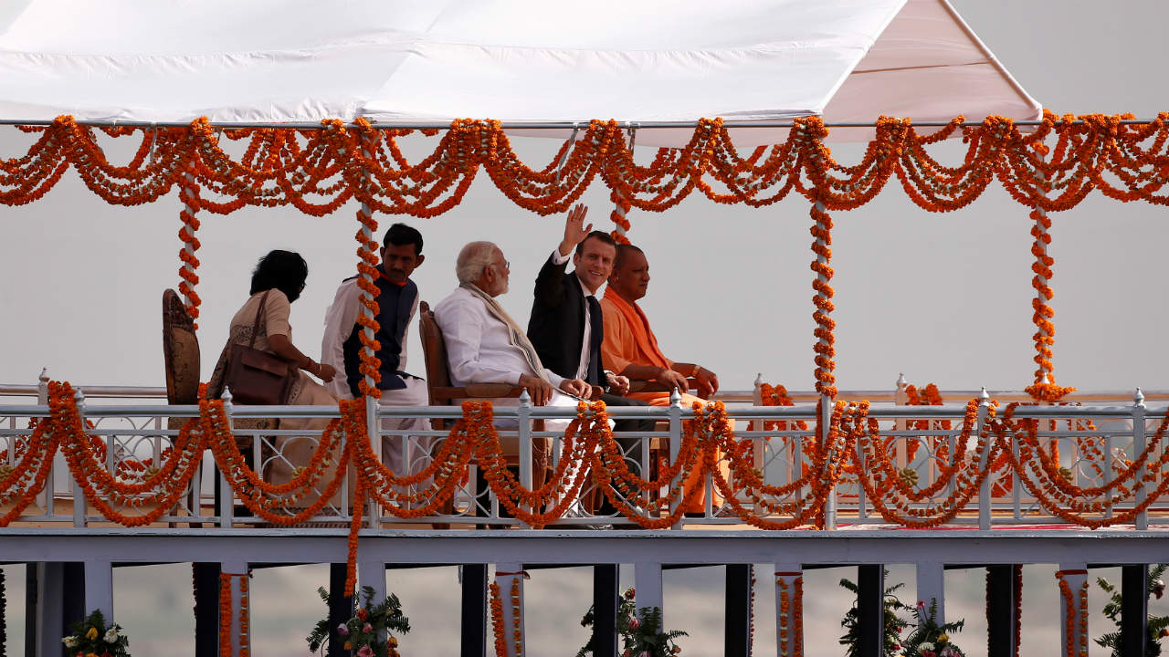 India's Prime Minister Narendra Modi, French President Emmanuel Macron and Uttar Pradesh Chief Minister Yogi Adityanath pictured aboard a boat in Varanasi. (Photo: Reuters)