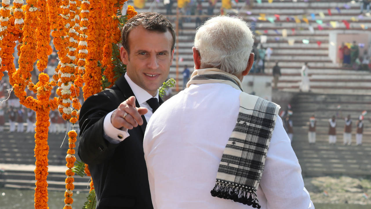 French President Emmanuel Macron and Indian Prime Minister Narendra Modi are seen on-board of a boat in Varanasi, Uttar Pradesh. (Photo: Reuters)