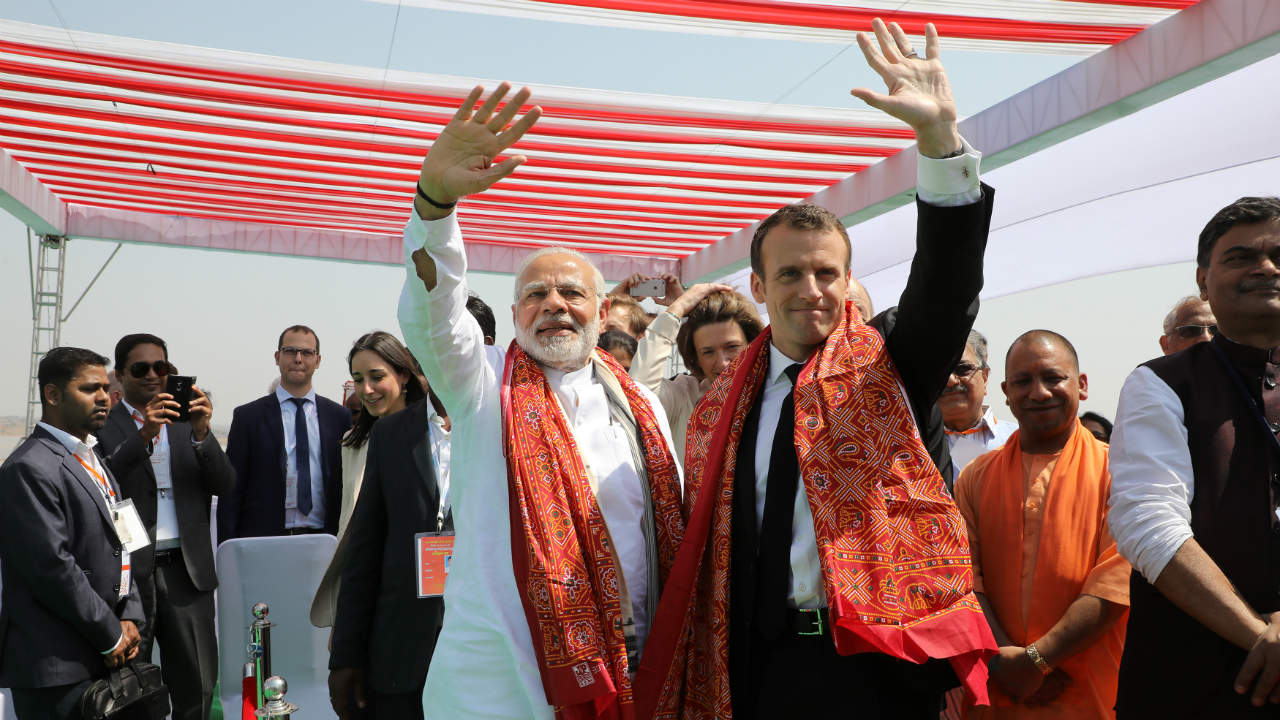 Indian Prime Minister Narendra Modi and French President Emmanuel Macron wave during the inauguration of a solar power plant in Mirzapur, Uttar Pradesh. (Photo: Reuters)
