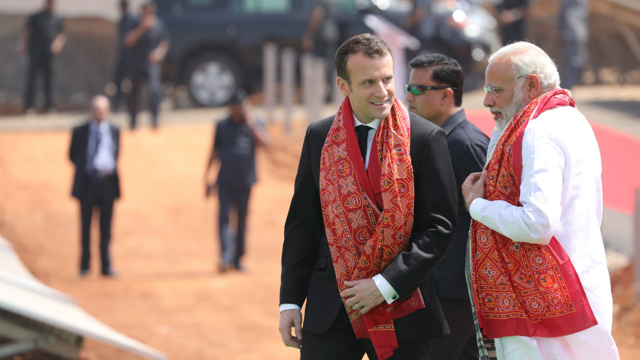 Indian Prime Minister Narendra Modi and French President Emmanuel Macron talk during the inauguration of a solar power plant in Mirzapur, Uttar Pradesh. (Photo: Reuters)