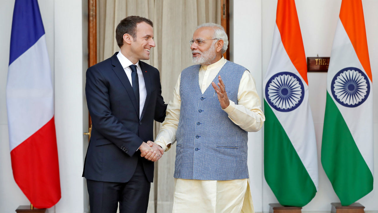 French President Emmanuel Macron shakes hands with India's Prime Minister Narendra Modi during a photo opportunity ahead of their meeting at Hyderabad House in New Delhi. (Photo: Reuters)