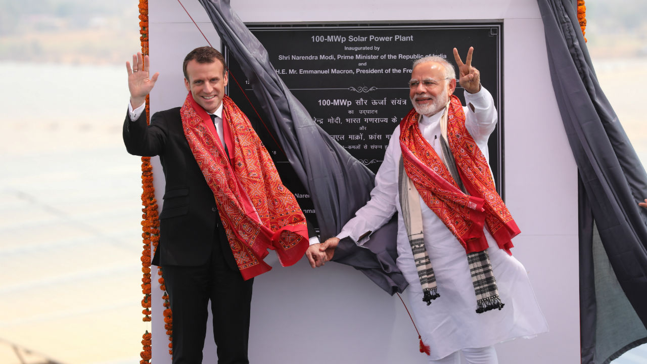 Indian Prime Minister Narendra Modi and French President Emmanuel Macron gesture during the inauguration of a solar power plant in Mirzapur, Uttar Pradesh. (Photo: Reuters)