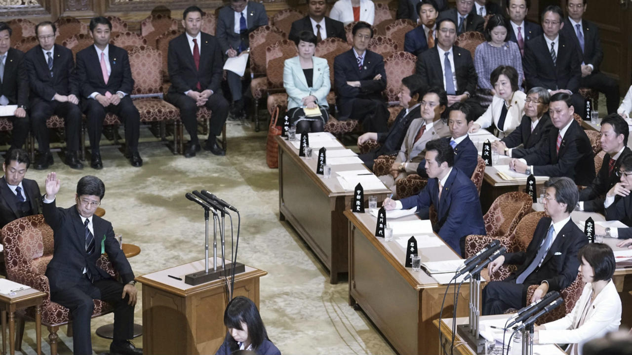 Nobuhisa Sagawa, left, a former National Tax Agency head, raises his hand to testify before an upper house panel at the parliament in Tokyo (AP/PTI)