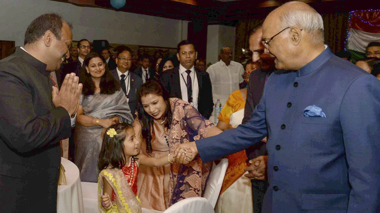 President Ram Nath Kovind and First Lady Savita Kovind greets a young girl during an Indian community reception hosted by Indian Ambassador in Madagascar Subir Dutta at Antananarivo. (PTI)