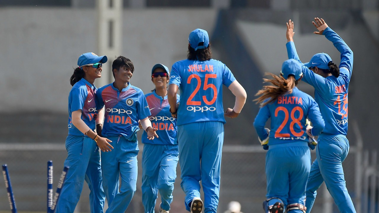 Indian cricket team members celebrate the dismissal of Australia's Ashleigh Gardner during the Women's T20I Tri-series at Brabourne stadium in Mumbai. (PTI)