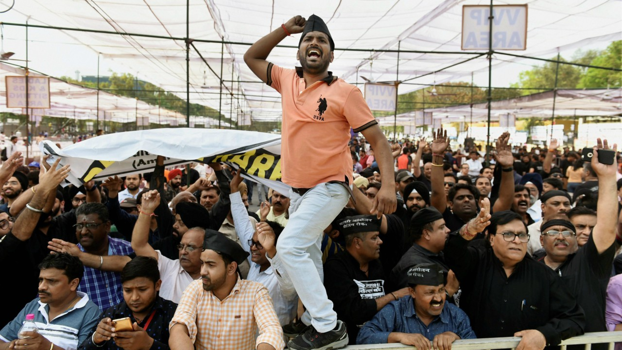 Traders raise slogans during a protest at Ramlila Ground in New Delhi, on Wednesday. Markets remain shut as traders, employees, and business owners stage a mega rally against the ongoing sealing drive. (PTI)