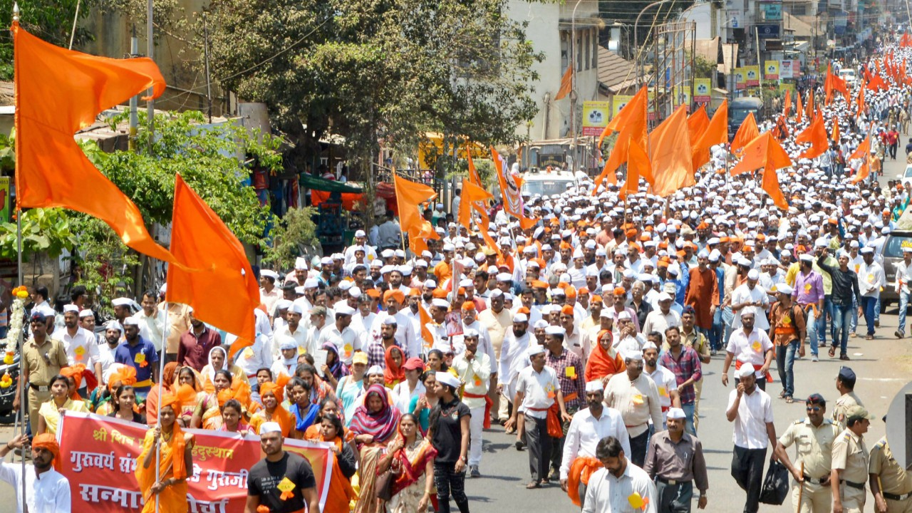 Members of Shiv Pratishthan take part in a protest rally demanding the removal of all the allegations against Sambhaji Bhide in Bhima Koregaon violence in Satara, Maharashtra. (PTI)