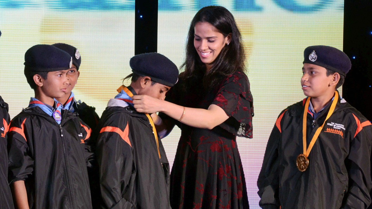Indian shuttler and programme Ambassador, Saina Nehwal presents an award to the finalists at the 8th Annual Pramerica Spirit of Community Awards 2018 in Gurugram on late Wednesday. (PTI)